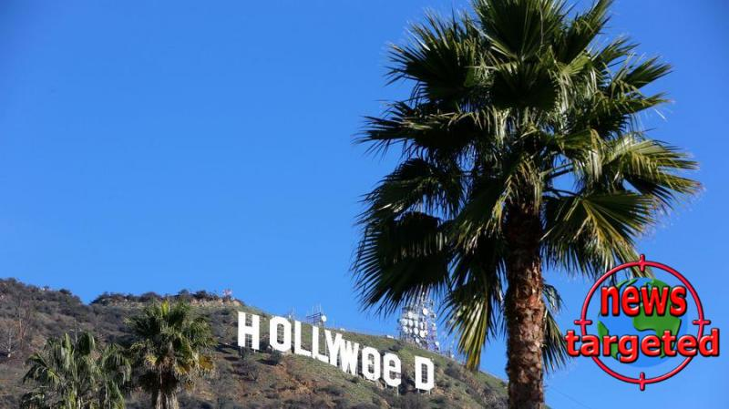 Hollywood sign altered to read...